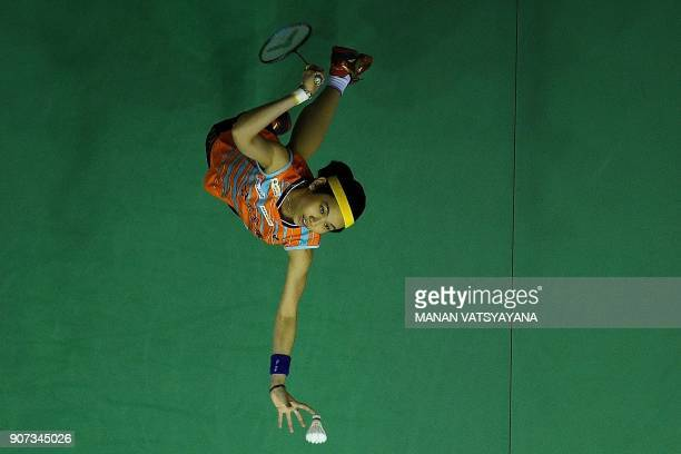 Taiwan'sTai Tzu Ying hits a return against Carolina Marin of Spain during their women's singles semifinal match of the 2018 Malaysia Masters...