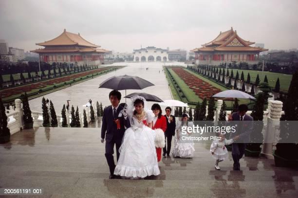 Taiwan,Taipei,wedding party with umbrellas at Chiang Kai Shek Memorial
