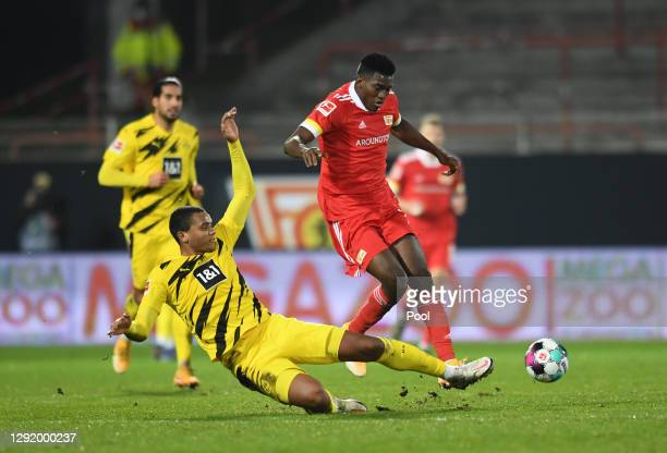 Taiwo Awoniyi of Union Berlin is tackled by Manuel Akanji of Borussia Dortmund during the Bundesliga match between 1. FC Union Berlin and Borussia...
