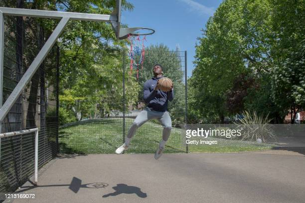 Taiwo plays basketball on a court in Elephant and Castle on May 15 2020 in London England Although recreational basketball was one of the activities...