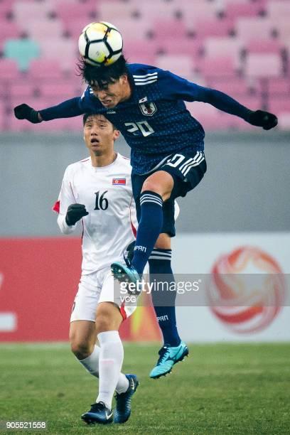 Taiyo Koga of Japan heads the ball during the AFC U-23 Championship Group B match between Japan and North Korea at Jiangyin Stadium on January 16,...