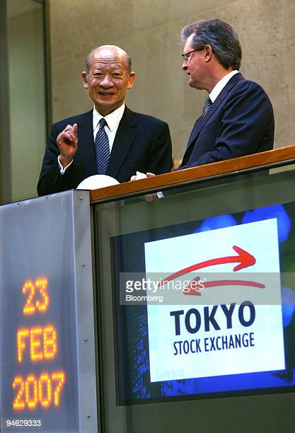 Taizo Nishimuro president and chief executive officer of the Tokyo Stock Exchange Inc talks with Chris GibsonSmith chairman of the London Stock...