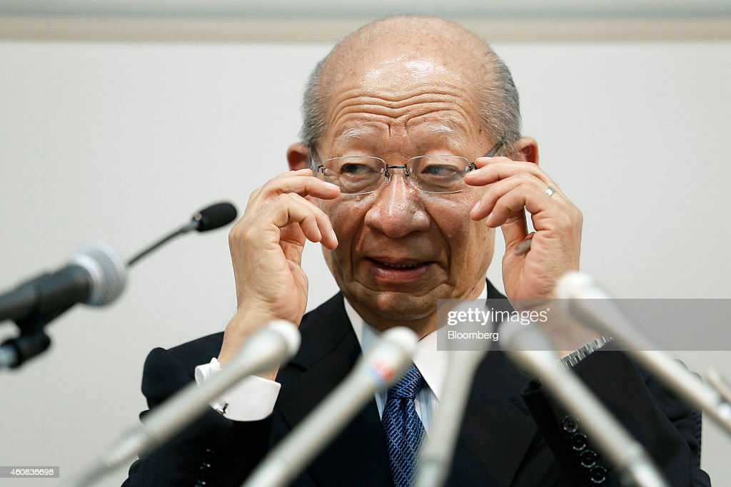 Taizo Nishimuro, president of Japan Post Holdings Co., adjusts his glasses during a news conference in Tokyo, Japan, on Friday, Dec. 26, 2014. Japan's government plans to split Japan Post into three listed companies by selling shares to the public in August or later as it privatizes the nation's biggest consumer bank. Photographer: Kiyoshi Ota/Bloomberg via Getty Images