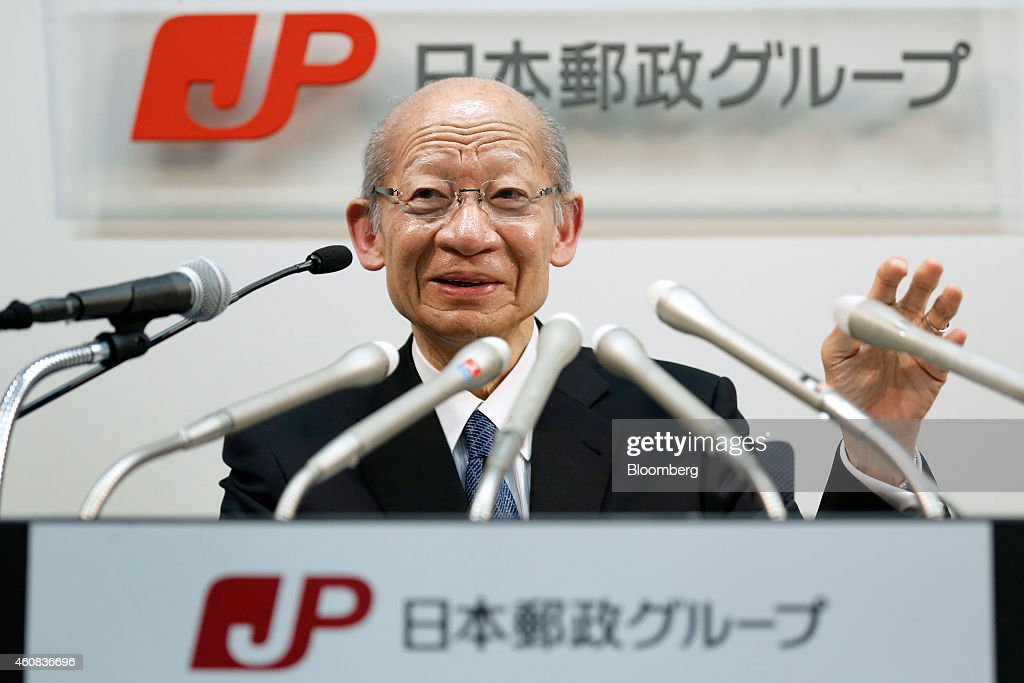 Taizo Nishimuro, president of Japan Post Holdings Co., gestures as he speaks during a news conference in Tokyo, Japan, on Friday, Dec. 26, 2014. Japan's government plans to split Japan Post into three listed companies by selling shares to the public in August or later as it privatizes the nation's biggest consumer bank. Photographer: Kiyoshi Ota/Bloomberg via Getty Images