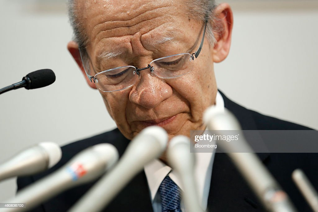 Taizo Nishimuro, president of Japan Post Holdings Co., pauses during a news conference in Tokyo, Japan, on Friday, Dec. 26, 2014. Japan's government plans to split Japan Post into three listed companies by selling shares to the public in August or later as it privatizes the nation's biggest consumer bank. Photographer: Kiyoshi Ota/Bloomberg via Getty Images