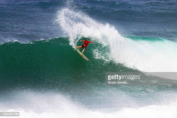 Taj Burrow of Australia surfs during the round of 64 at the Vans World Cup of Surfingon December 1 2011 in Sunset Beach United States