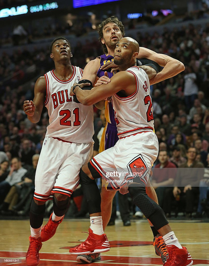 Taj Gibson #22 and Jimmy Butler #21 of the Chicago Bulls box out Pau Gasol #16 of the Los Angeles Lakers at the United Center on January 21, 2013 in Chicago, Illinois. The Bulls defeated the Lakers 95-83.