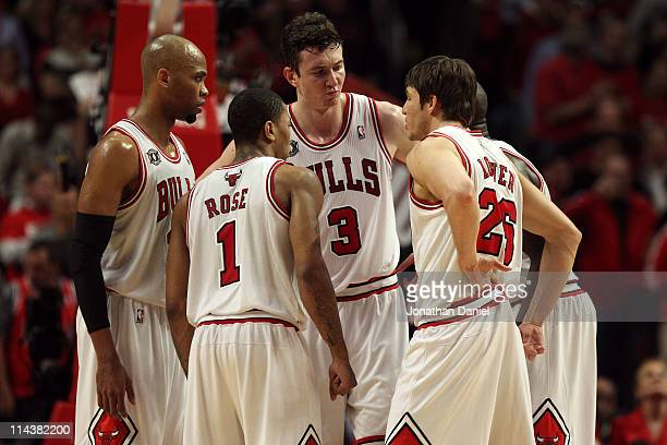 Taj Gibson Derrick Rose Omer Asik and Kyle Korver of the Chicago Bulls huddle up against the Miami Heat in Game Two of the Eastern Conference Finals...
