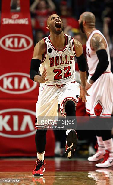 Taj Gibson of the Chicago Bulls celebrates after a dunk against the Indiana Pacers at the United Center on March 24 2014 in Chicago Illinois The...