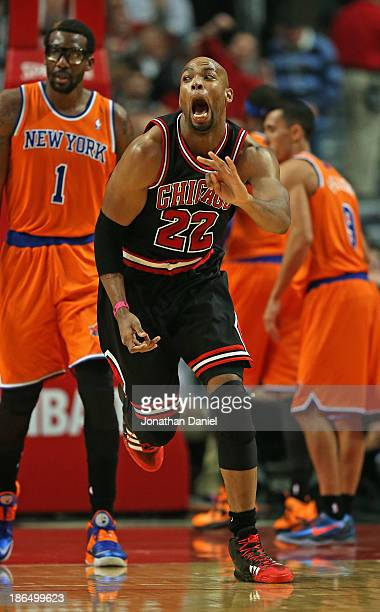 Taj Gibson of the Chicago Bulls celebrates hitting a shot at the buzzer ending the 1st quarter against the New York Knicks at the United Center on...