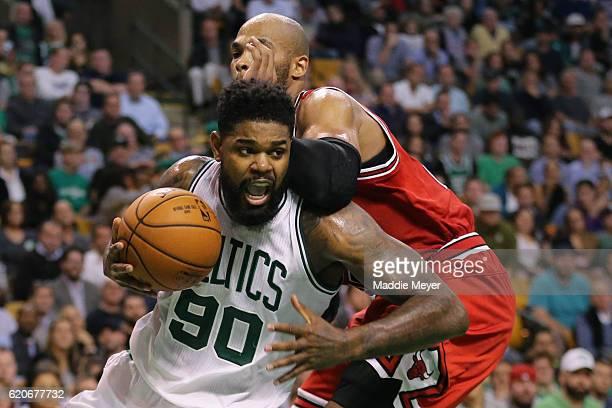 Taj Gibson of the Chicago Bulls defends Amir Johnson of the Boston Celtics during the third quarter at TD Garden on November 2 2016 in Boston...