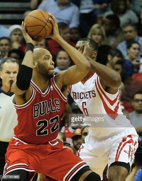 Taj Gibson of the Chicago Bulls drives with the ball against Terrence Jones of the Houston Rockets during the game at Toyota Center on December 18...