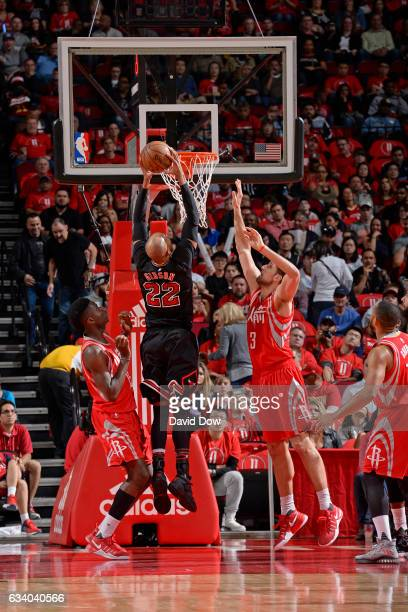 Taj Gibson of the Chicago Bulls dunks the ball against the Houston Rockets on February 3 2017 at the Toyota Center in Houston Texas NOTE TO USER User...