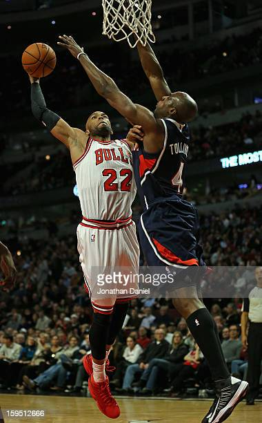 Taj Gibson of the Chicago Bulls goes up for a dunk against Anthony Tolliver of the Atlanta Hawks at the United Center on January 14 2013 in Chicago...