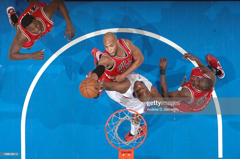 Taj Gibson #22 of the Chicago Bulls goes up for a shot against Lamar Odom #7 of the Los Angeles Clippers at Staples Center on November 17, 2012 in Los Angeles, California.