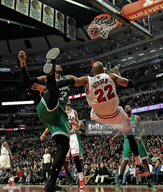 Taj Gibson of the Chicago Bulls hits a shot and then hits the floor on a flagrant foul by Jared Sullinger of the Boston Celtics at the United Center...