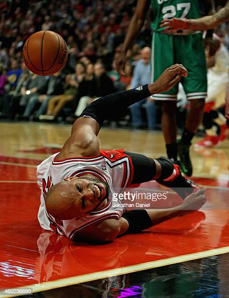 Taj Gibson of the Chicago Bulls hits the floor hard after a flagrant foul by Jared Sullinger of the Boston Celtics at the United Center on January 2...