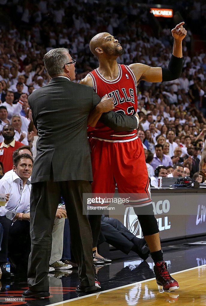 Taj Gibson #22 of the Chicago Bulls is ejected after arguing with referee Scott Foster #48 during Game Two of the Eastern Conference Semifinals of the 2013 NBA Playoffs against the Miami Heat at American Airlines Arena on May 8, 2013 in Miami, Florida.