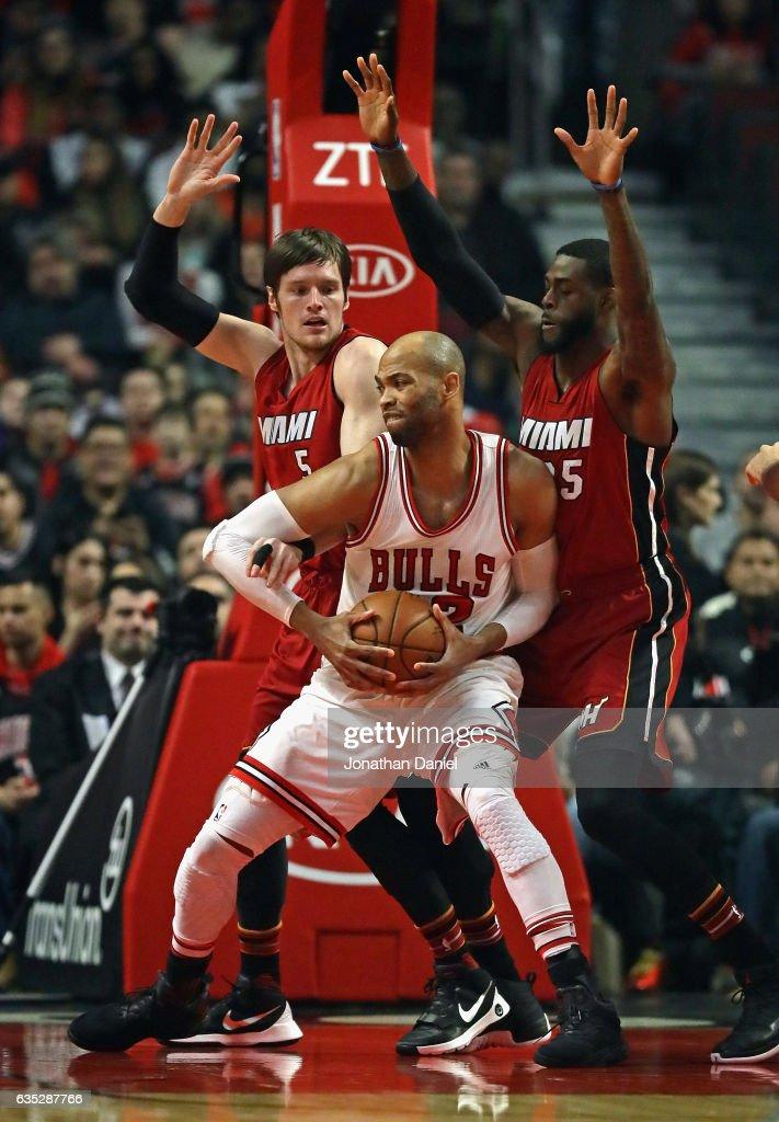 Taj Gibson of the Chicago Bulls moves against Luke Babbitt