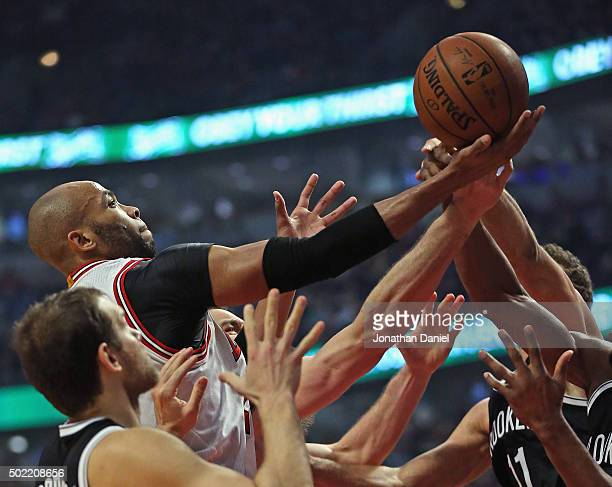 Taj Gibson of the Chicago Bulls puts up a shot against the Brooklyn Nets at the United Center on December 21 2015 in Chicago Illinois The Nets...