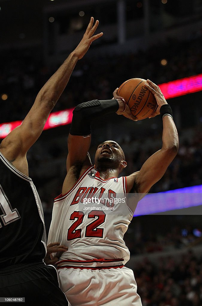 Taj Gibson #22 of the Chicago Bulls puts up a shot against Tim Duncan #21 of the San Antonio Spurs at the United Center on February 17, 2011 in Chicago, Illinois. The Bulls defeated the Spurs 109-99.