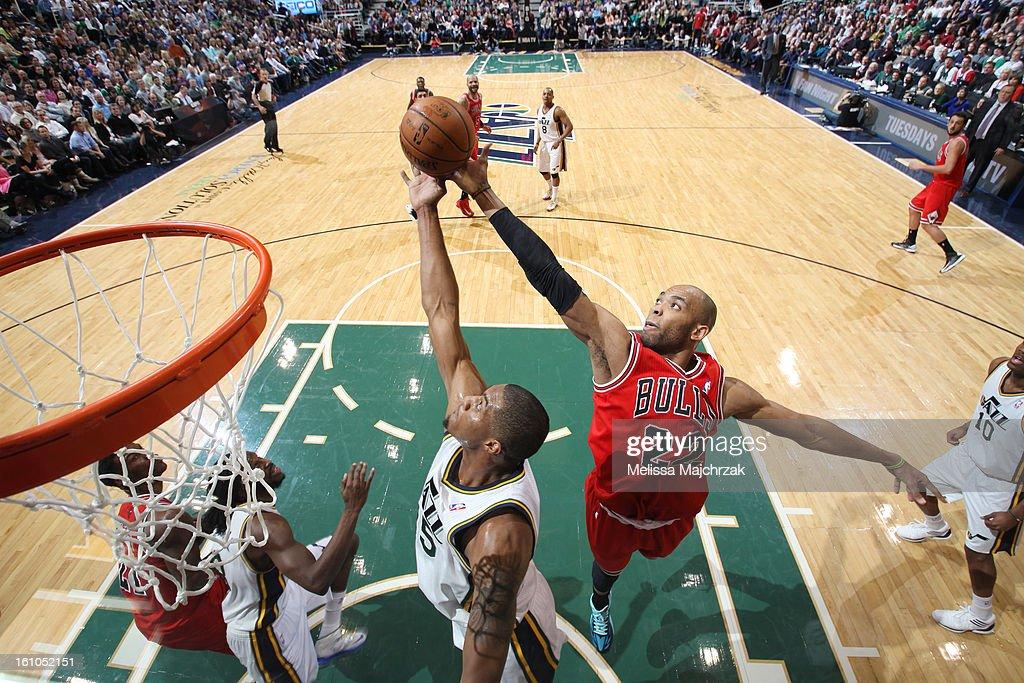 Taj Gibson #22 of the Chicago Bulls reaches for a rebound against Derrick Favors #15 of the Utah Jazz at Energy Solutions Arena on February 08, 2013 in Salt Lake City, Utah.