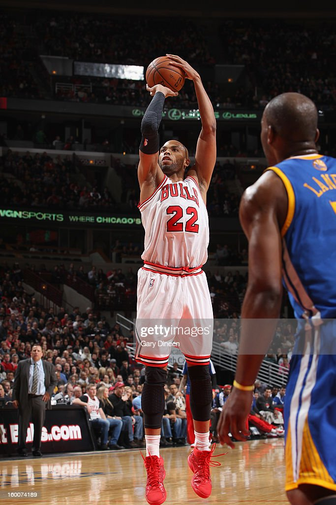 Taj Gibson #22 of the Chicago Bulls shoots against the Golden State Warriors on January 25, 2012 at the United Center in Chicago, Illinois.