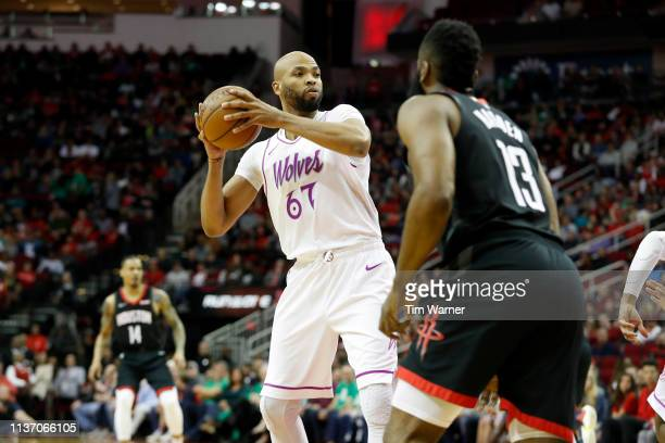 Taj Gibson of the Minnesota Timberwolves controls the ball in front of James Harden of the Houston Rockets in the first half at Toyota Center on...