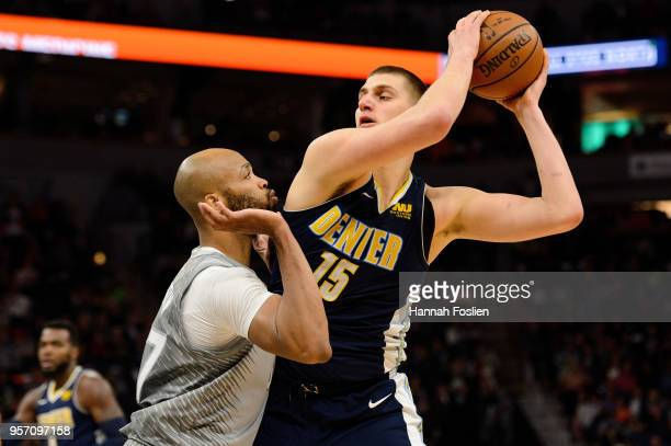 Taj Gibson of the Minnesota Timberwolves defends against Nikola Jokic of the Denver Nuggets during the game on April 11 2018 at the Target Center in...