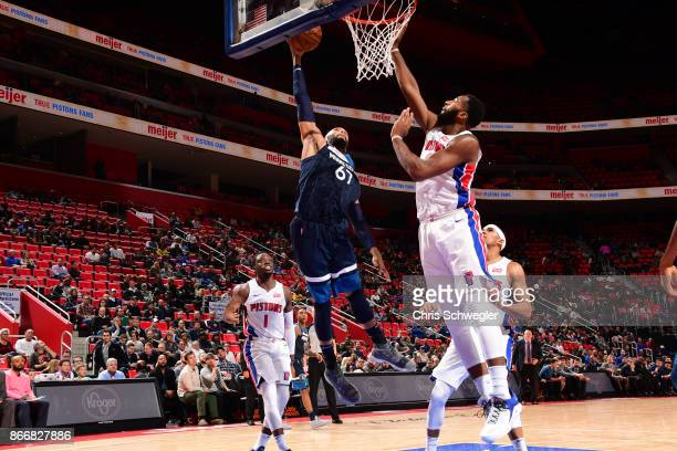 Taj Gibson of the Minnesota Timberwolves drives to the basket against the Detroit Pistons on October 25 2017 at Little Caesars Arena in Detroit...