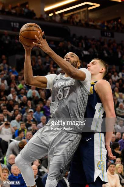 Taj Gibson of the Minnesota Timberwolves shoots the ball against Nikola Jokic of the Denver Nuggets during the game on April 11 2018 at the Target...