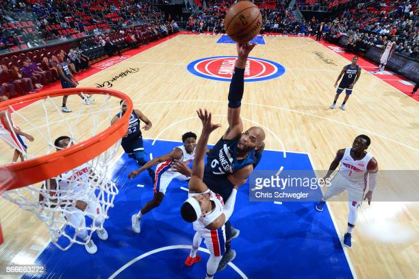 Taj Gibson of the Minnesota Timberwolves shoots the ball against the Detroit Pistons on October 25 2017 at Little Caesars Arena in Detroit Michigan...