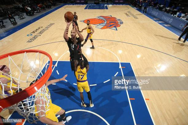 Taj Gibson of the New York Knicks shoots the ball during the game against the Los Angeles Lakers on April 12, 2021 at Madison Square Garden in New...