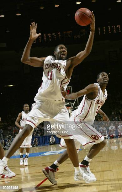 Taj Gray of the University of Oklahoma Sooners rebounds against the University of Utah Utes during the second round of the NCAA Men's Basketball...