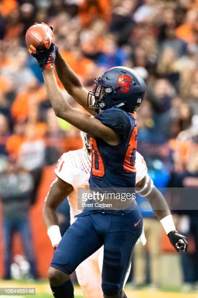 Taj Harris of the Syracuse Orange makes a first down reception during the first quarter against the North Carolina State Wolfpack at the Carrier Dome...