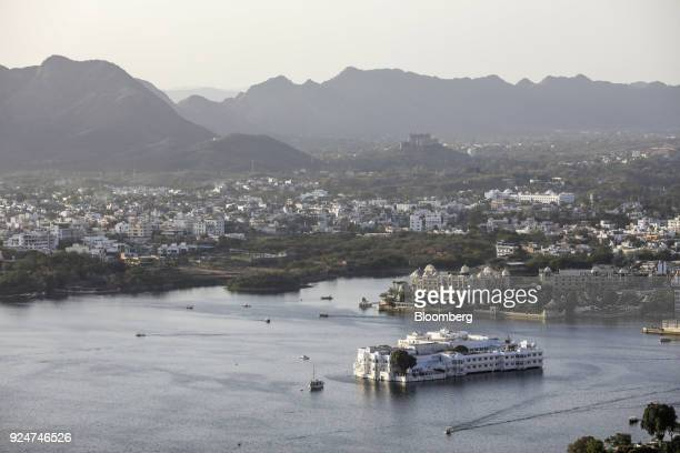 Taj Lake Palace hotel standing in Lake Pichola is seen from the Karni Mata temple complex in Udaipur Rajasthan India on Saturday Feb 24 2018 On Feb...