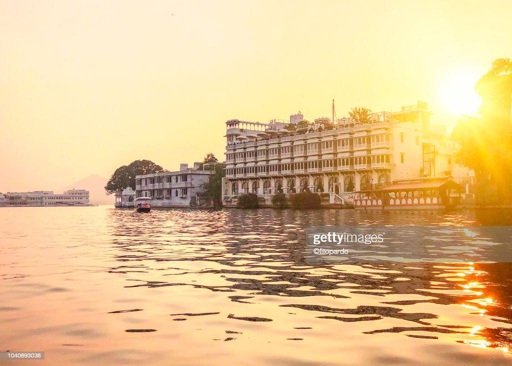 Taj Lake Palace, Lake Pichola, and some buildings : Stock Photo