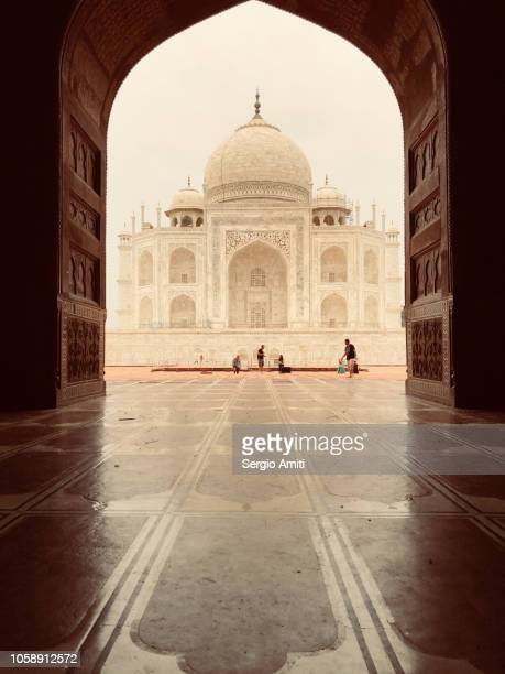 Taj Mahal framed through an arched doorway