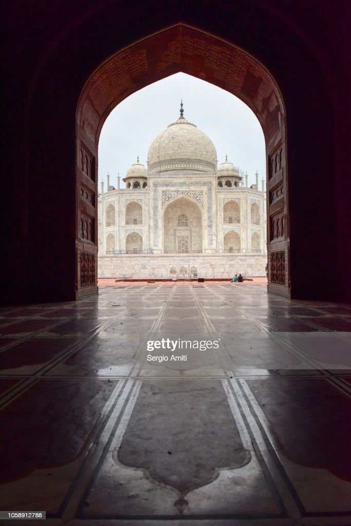 Taj Mahal framed through an arched doorway : Stock Photo
