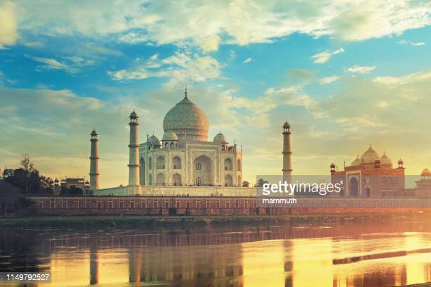 taj mahal in agra, india at sunset - taj mahal stock pictures, royalty-free photos & images
