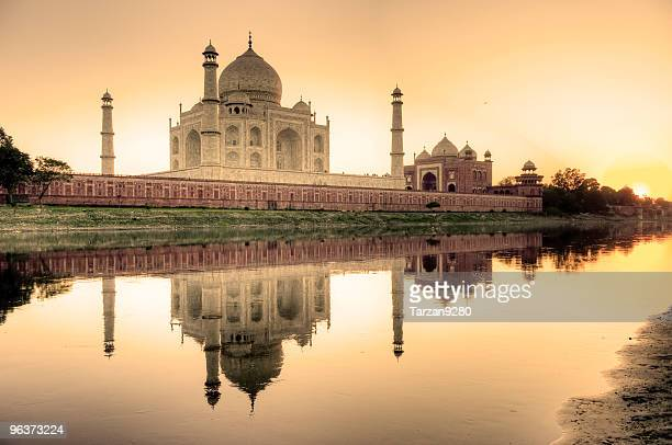 taj mahal reflected in the yamuna river - taj mahal stock photos and pictures