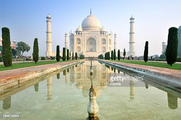 taj mahal sunrise with reflection - taj mahal stock photos and pictures