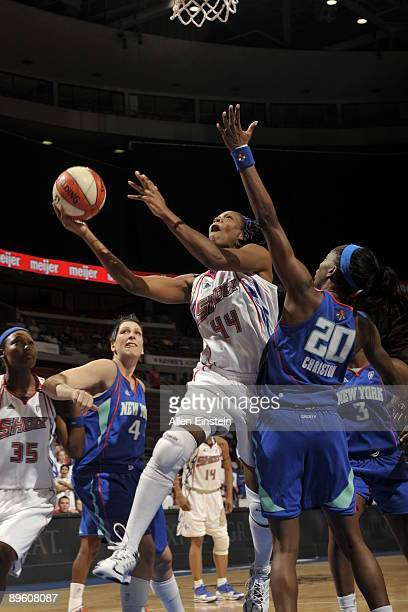 Taj McWilliams of the Detroit Shock goes up for a shot against Shameka Christon of the New York Liberty on August 4 2009 at The Palace of Auburn...
