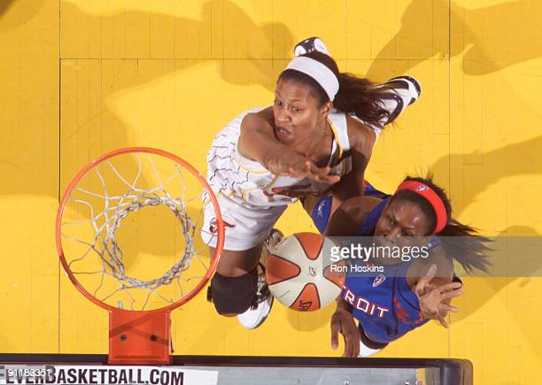 Taj McWilliams of the Detroit Shock shoots over Jessica Moore of the Indiana Fever during Game Three of the WNBA Eastern Conference Finals at Conseco...