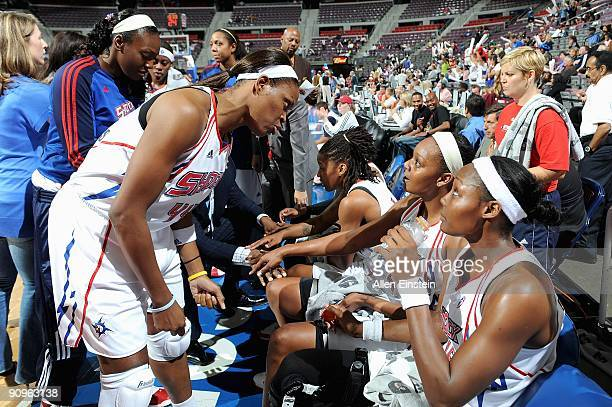 Taj McWilliams talks to Olayinka Sanni and Cheryl Ford of the Detroit Shock during the game against the Atlanta Dream in Game one of the Eastern...