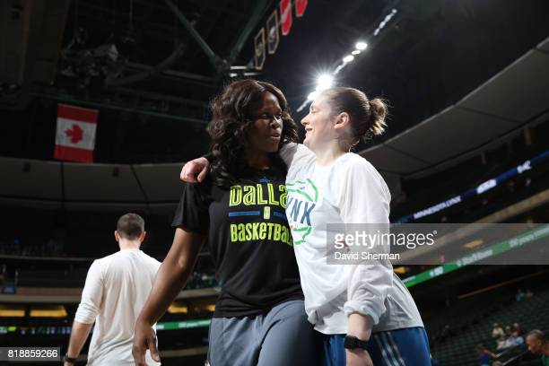 Taj McWilliamsFranklin former WNBA player and presently assistant coach of the Dallas Wings hugs Lindsay Whalen of the Minnesota Lynx before the game...