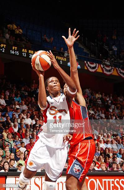 Taj McWilliamsFranklin of the Connecticut Sun goes to the basket against Tammy SuttonBrown of the Charlotte Sting during the game at Mohegan Sun on...