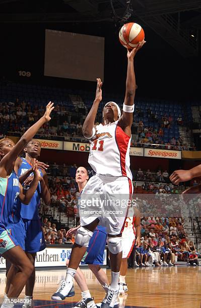 Taj McWilliamsFranklin of the Connecticut Sun goes to the basket against the New York Liberty on August 1 2006 at Mohegan Sun Arena in Uncasville...