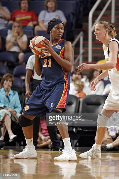 Taj McWilliamsFranklin of the Connecticut Sun looks to pass against of the Phoenix Mercury in a WNBA game played on June 16 at US Airways Center in...
