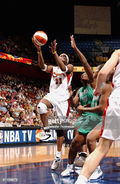 Taj McWilliamsFranklin of the Connecticut Sun shoots a layup against Vanessa Hayden and Tamika Williams of the Minnesota Lynx during the game on July...